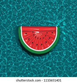 Inflatable watermelon pool float, ring floating in a pool. Watermelon shape inflatable ring. 3D Illustration.