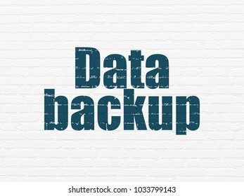 Information concept: Painted blue text Data Backup on White Brick wall background