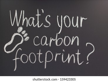 inscription in chalk on a blackboard what's your carbon footprint?