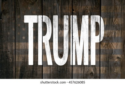 Inscription Trump on wooden background. President