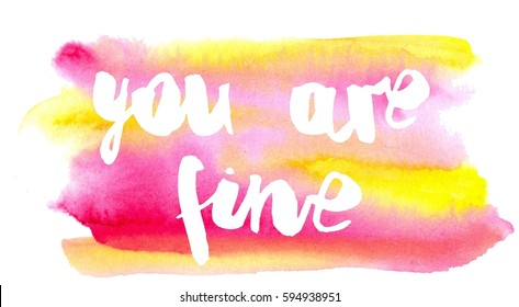 Inspiration colorful handwritten lettering, white words on pink and yellow watercolor background: You are fine.