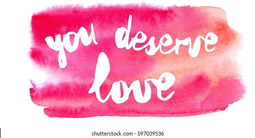Inspiration colorful handwritten lettering, white words on pink watercolor background: You deserve love.