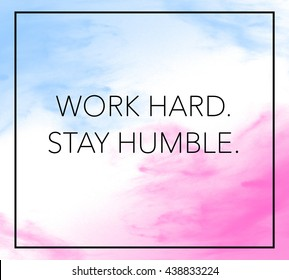 "Inspirational life quote with phrase ""Work Hard, Stay Humble"" with color splash brushed background."