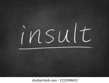 insult concept word on a blackboard background