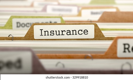 Insurance - Folder Register Name in Directory. Colored, Blurred Image. Closeup View.