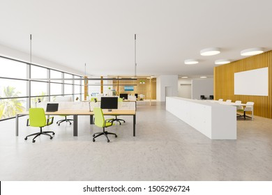 Interior of bright open space office with white and wooden walls, panoramic windows, rows of computer tables with green chairs and conference table with mock up poster. 3d rendering