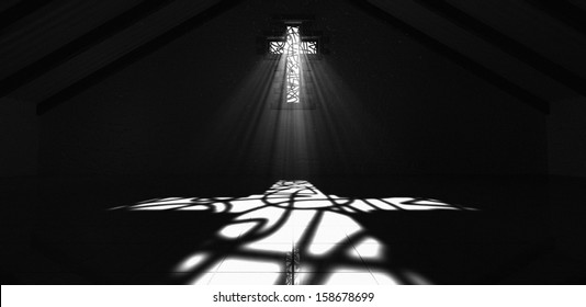 An interior building with a crucifix shaped stained glass window with a spotlight rays penetrating through it reflecting the image on the floor