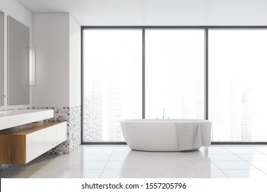 Interior of comfortable bathroom with white and mosaic walls, tiled floor, cozy white sink with cabinets and vertical mirrors and bathtub near panoramic window. 3d rendering