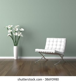 interior design scene with a white modern chair and a vase of calla lilly on a pale green wall