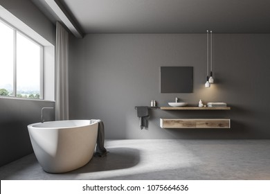 Interior of a gray bathroom with a concrete floor, a large window with gray curtains, a white bathtub and a sink. 3d rendering