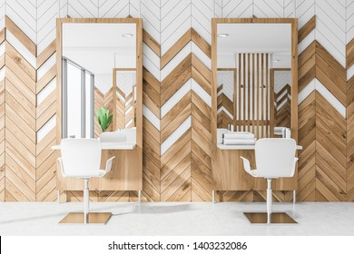 Interior of hairdresser studio or beauty salon with white and wooden walls, concrete floor, large mirrors near small tables with creams and towels and white chairs. 3d rendering