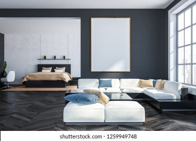 Interior of living room with gray walls, dark wooden floor, white and black sofa standing near square coffee table with bedroom in the background. Vertical poster. 3d rendering mock up