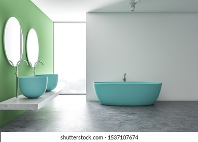 Interior of loft bathroom with white and green walls, concrete floor, massive blue double sink with round mirrors and comfortable blue bathtub. 3d rendering