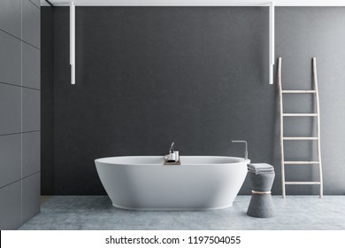 Interior of luxury bathroom with gray tile walls, concrete floor, white bathtub and wooden ladder in the corner. 3d rendering