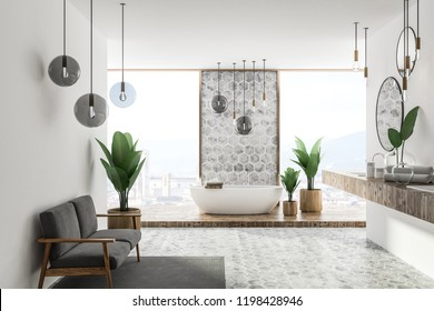Interior of luxury bathroom with white and honeycomb pattern walls and floor, panoramic window, bathtub and double sink with round mirrors hanging above it. A couch. 3d rendering copy space