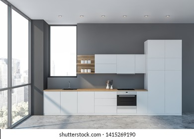 Interior of luxury kitchen with gray walls, concrete floor, white cupboards and countertops with built in sink, cooker and oven. 3d rendering