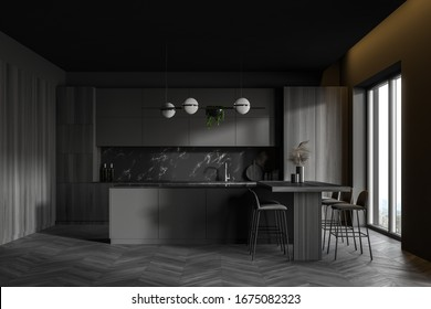 Interior of luxury kitchen with grey, black marble and wooden walls, dark wooden floor, wooden countertops, gray island and bar table with stools. 3d rendering