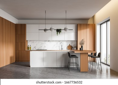 Interior of luxury kitchen with white, marble and wooden walls, concrete floor, wooden countertops, white island and bar table with stools. 3d rendering