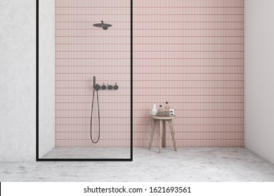 Interior of minimalistic bathroom with white and pink tile walls, concrete floor, comfortable walk in shower with glass wall and chair with beauty products. 3d rendering
