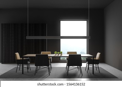 Interior of minimalistic dining room with dark gray walls, concrete floor, long gray table with chairs standing on carpet and wooden wardrobe. 3d rendering