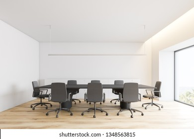 Interior of minimalistic meeting room with white walls, wooden floor, long gray conference table with gray chairs and white cabinets. Concept of negotiation. 3d rendering