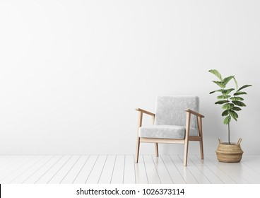 Interior mock up with gray velvet armchair and fiddle leaf tree in wicker basket in living room with white wall. 3D rendering.