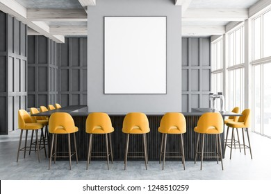 Interior of modern bar with gray walls, concrete floor, big windows, dark wooden and gray bar with yellow stools standing near it. Vertical poster on the wall. 3d rendering mock up