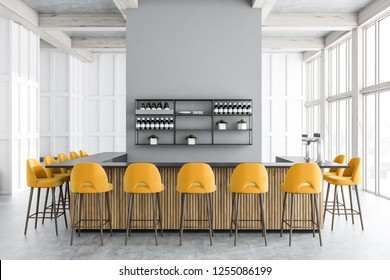 Interior of modern bar with white walls, concrete floor, big windows, wooden and gray bar with yellow stools standing near it. Shelves with wines. 3d rendering