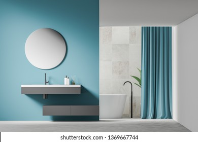 Interior of modern bathroom with blue, tiled and white walls, white floor, gray sink with round mirror and white bathtub with blue curtains. 3d rendering