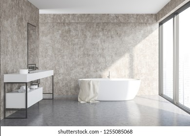 Interior of modern bathroom with concrete walls and floor, loft window, white bathtub and white sink with vertical mirror above it. 3d rendering