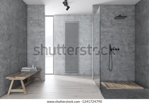 Interior of modern bathroom with concrete walls, wooden floor, shower with glass wall and wooden bench with towels and shampoo. 3d rendering