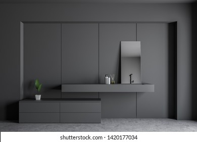 Interior of modern bathroom with dark gray walls, concrete floor, gray sink with mirror on it and gray cabinets. 3d rendering