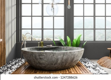Interior of modern bathroom with gray walls, tiled floor, windows with mountain view and stone bathtub. 3d rendering