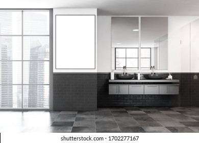 Interior of modern bathroom with white and black brick walls, tiled floor, comfortable grey double sink with two vertical mirrors. Vertical mock up poster. Window with blurry cityscape. 3d rendering