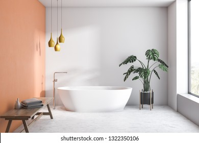 Interior of modern bathroom with white and orange walls, concrete floor, white bathtub and bench with towels and creams. 3d rendering