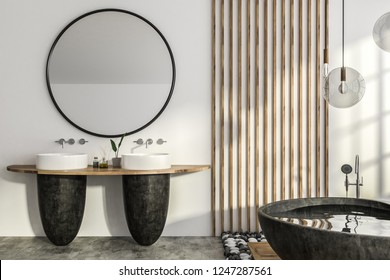 Interior of modern bathroom with white and wooden walls, concrete floor, black round bathtub and two round sinks standing on wooden shelf with round mirror above it. 3d rendering