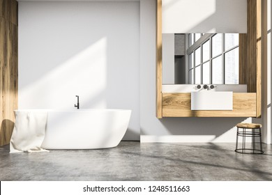 Interior of modern bathroom with white and wooden walls, concrete floor, white bathtub and sink standing on wooden countertop. 3d rendering