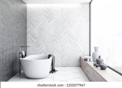 Interior of modern bathroom with white wooden and concrete walls, tiled floor, panoramic window with a cityscape and white bathtub. 3d rendering