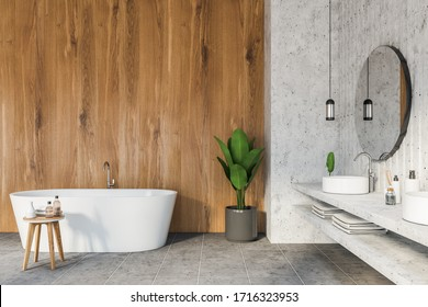 Interior of modern bathroom with white and wooden walls, tiled floor, double sink with two round mirrors and comfortable white bathtub. 3d rendering
