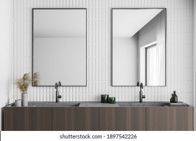 Interior of modern bathroom with white and wooden walls and double sink with tow mirrors. 3d rendering