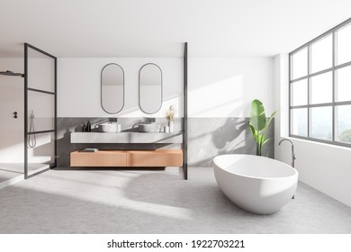 Interior of modern bathroom with white and wooden walls, concrete floor, double sink with two mirrors above it and comfortable white bathtub. 3d rendering
