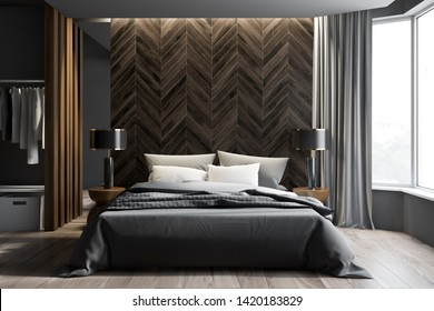 Interior of modern bedroom with gray and dark wooden walls, wooden floor, master bed with two round bedside tables with lamps and wardrobe with clothes. 3d rendering