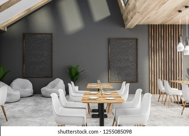 Interior of modern cafe with gray walls, concrete floor, wooden tables with white chairs and gray armchairs. Blackboards on the wall. 3d rendering