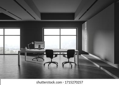 회색의 벽, 콘크리트 바닥, 편안한 컴퓨터 테이블 및 방문객용 의자를 갖춘 현대적인 CEO의 사무실 내부흐릿한 산경이 보이는 창관리의 개념.3d 렌더링