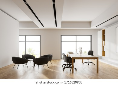 Interior of modern CEO office with white walls, wooden floor, comfortable computer table with chairs for visitors. Lounge area with grey armchairs. Window with blurry tropical view. 3d rendering