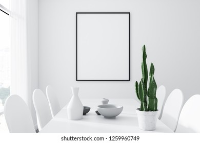 Interior of modern dining room with white walls, concrete floor, big window, long white table with white chairs and vertical mock up poster on the wall. 3d rendering