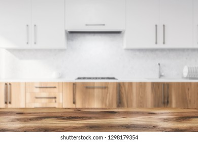 Interior of modern kitchen with concrete walls, wooden countertops with built in sink and cooker and white cupboards. 3d rendering blurred