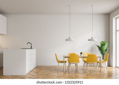 Interior of modern kitchen with white walls, wooden floor, white island with built in sink and wooden table with yellow chairs. 3d rendering