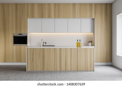 Interior of modern kitchen with white walls, wooden countertops and cupboards with built in cooker and oven and island with sink. 3d rendering