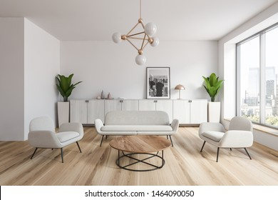 Interior of modern living room with white walls, wooden floor, white sofa and armchairs near round coffee table and wooden cabinet with picture of city. 3d rendering
